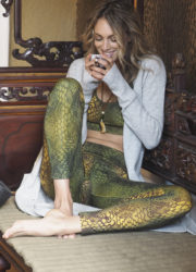 Kismet Yoga Bra top Siwa snake olive multicolor_Yoga Leggings Devi snake olive multicolor_Yogini relaxed on Bali sofa